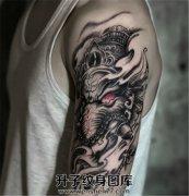传统大臂象神纹身