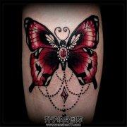 女性小臂彩色蝴蝶纹身