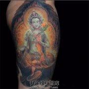 女性大腿佛纹身