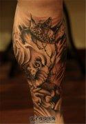 男性小腿象神纹身传统黑灰纹身