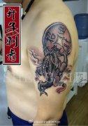 重庆纹身  江北纹身 手臂金蟾纹身图案