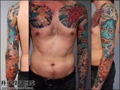 男性传统花臂彩色般若牡丹纹身图片大全