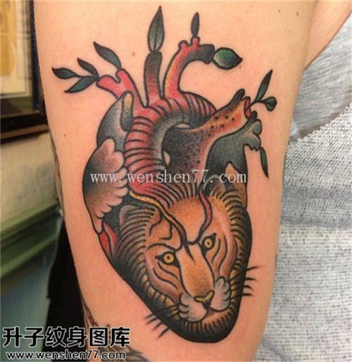 女性大臂欧美彩色老虎心脏纹身图片大全