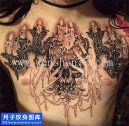 重庆纹身哪里便宜 男性欧美花胸骷髅蜡烛纹身图