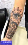 手臂指南针眼睛玫瑰花纹身图案