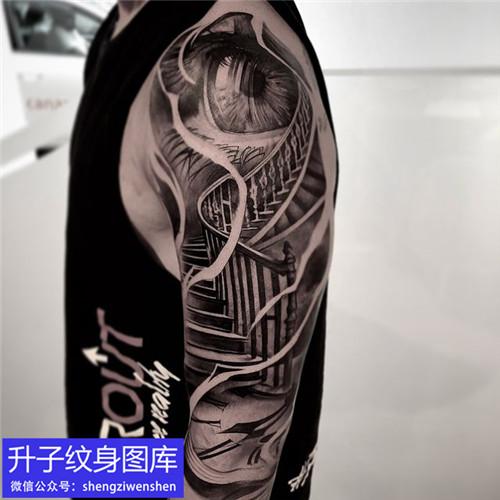 大臂外侧黑灰天梯与眼睛纹身图案